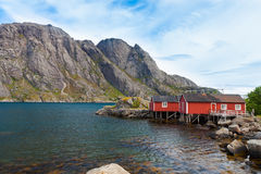Typical red rorbu fishing hut in village Nusfjord Royalty Free Stock Photo