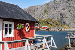 Typical red rorbu fishing hut in village Nusfjord Royalty Free Stock Photography