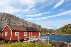 Typical red rorbu fishing hut in village Nusfjord Stock Photos