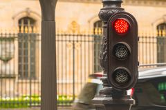 Typical red traffic light in Paris in France stock photo