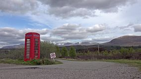 Typical red uk phone box in the highlands. Typical red uk phone box in the scottish highlands stock video