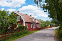 Typical Red wooden cottages in Pataholm, Royalty Free Stock Image