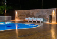 Typical relax zone with swimming pool at a luxury, tropical resort at night Royalty Free Stock Photography