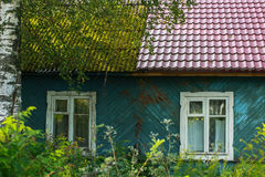 A residential wooden house in settlement in Leningrad region, Russia. Stock Photos