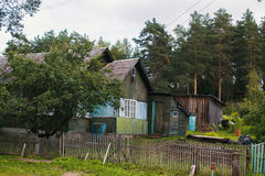 Typical residential wooden house in settlement in Leningrad region. Royalty Free Stock Photo