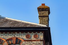 The typical roof with chimney of a house in United Kingdom stock photos