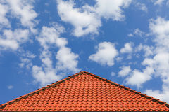 Typical roof tiles with blue cloudy sky Stock Images