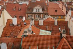 Typical roofs in Prague. Top view - roofs with red tiles in old buildings in Prague. Europe. Stock Photography