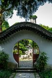 A typical round Chinese entrance in the Jiangxin island in Wenzhou in China with the view of the East Pagoda on the   bacground. 1 royalty free stock image
