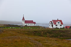 Typical Rural Icelandic church and house Stock Images