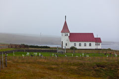 Typical Rural Icelandic church with local cemetery Stock Photo