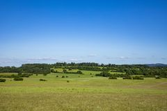 Typical rural landscape with meadows and fields in the Jura region, departement Bourgogne. France royalty free stock photography