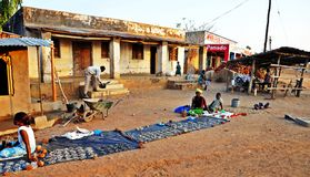 Typical Rural Malawi Village. A typical scene in impoverished rural Malawi. Vendors trying to eke out a living by selling sun dried fish, vegetables & salt Stock Photo