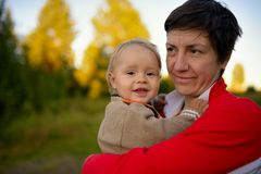 Typical rural woman with little boy outside Stock Photo