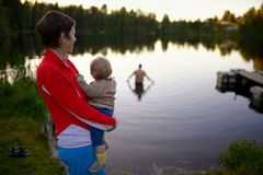 Typical Russian rural family on the forest lake Royalty Free Stock Photo