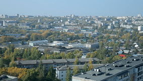 A typical Russian town in the summer. A typical town of Central Russia. The view from the top. There are low houses, trees, cranes stock footage