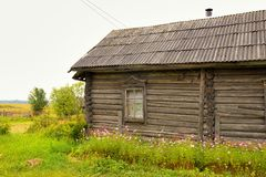 Typical russian village house in the countryside Stock Photos