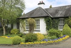 Typical rustic cottage with a beautiful garden. In front of the house. Ireland royalty free stock photography