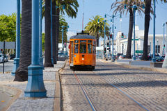 Typical San Francisco train traveling down the Embarcadero on a Royalty Free Stock Photo
