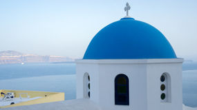 Typical Santorini church. A typical church in Santorini island, Greece, with white walls and a blue dome Stock Image