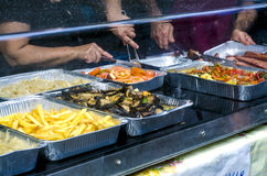 Typical Sardinian food. Counter sale with fried potatoes, tomato Royalty Free Stock Photography
