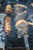 Typical Sardinian food. Piglets roast and entrails of animals ro Stock Image