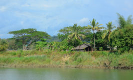 Typical scene of Burmese village on the riverbank Stock Images
