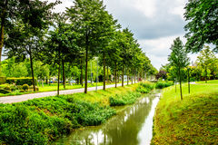 Typical scene of a canal running through the historic village of Midden Beemster Royalty Free Stock Image