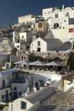 Typical scene from the Greek island of Santorini. A typical scene on the popular volcanic Greek island of Santorini, Greece.  Every year millions of tourists Royalty Free Stock Images