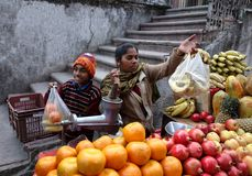 Indian Boy and Mother Selling Fruit royalty free stock photography