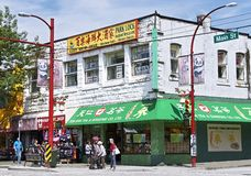 Typical scenery at a corner at Main Street in Chinatown, Vancouver, Canada stock images