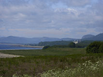 Typical Scottish Highlands landscape with castle and mountains Royalty Free Stock Images