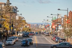 Typical Shopping street in Cote des Neiges district, with small and medium businesses, cars passing by and pedestrians crossing. Picture of Cote des Neiges Road royalty free stock photo