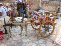 Typical Sicilian cart representing the folklore of the island. Typical Sicilian cart depicting the folklore of the island, full of drawings related to the Royalty Free Stock Photography