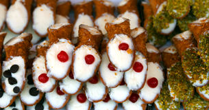 typical Sicilian pastries called CANNOLI with cherries Royalty Free Stock Images