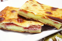 Typical Sicilian sfoglia pizza with ham and cheese Royalty Free Stock Image