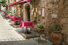 Typical sidewalk restaurant scene in Tuscany Stock Photo