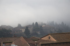 Typical Siena houses in the thick fog . Tuscany, Italy. royalty free stock images