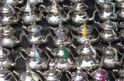 The typical silver teapots in silver metal stock image