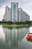 Typical Singapore highrise public housing estate beside river. Royalty Free Stock Images