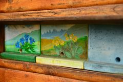 Typical slovenian apiary with unique beehive panels. Typical slovenian apiary with unique beehive panels near Lukovica town Royalty Free Stock Photos