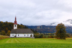 Typical slovenian church in the mountains Stock Photography