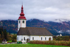 Typical slovenian church in the mountains Stock Image