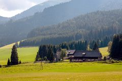 A typical small Austrian village at the foot of the Alpine mountains.  stock photography
