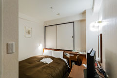 A typical small business hotel room in Japan. FUKUOKA, JAPAN - NOVEMBER 13: Business hotel room in Fukuoka, Japan on November 13, 2013. A typical small business Stock Photo