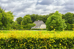 Typical Small Danish House In Green Park With Cloudscape in Back Royalty Free Stock Photography