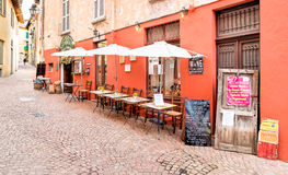 Typical small Italian outdoor wine bar in the historic center of Luino, Italy