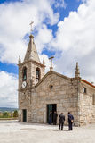 Typical small parish church during mass with men waiting outside. Royalty Free Stock Image