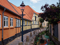 Typical small street with old houses Denmark Stock Images