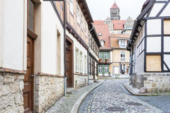 Typical small street in in Quedlinburg town, Germany Stock Photos